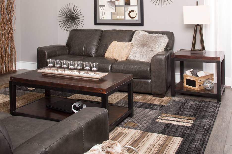 Sofa, rug, wall art, and end tables