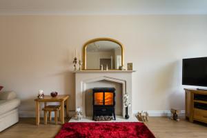 Layered area rugs livingroom