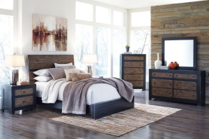 Bedroom set with area rug layered