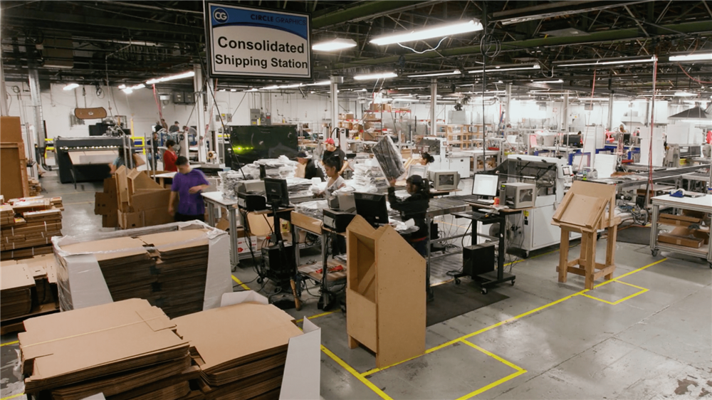 Workers packing canvases for shipping
