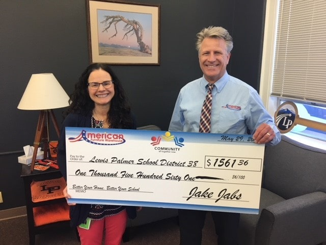 Presenting a check to Lewis-Palmer School District 38