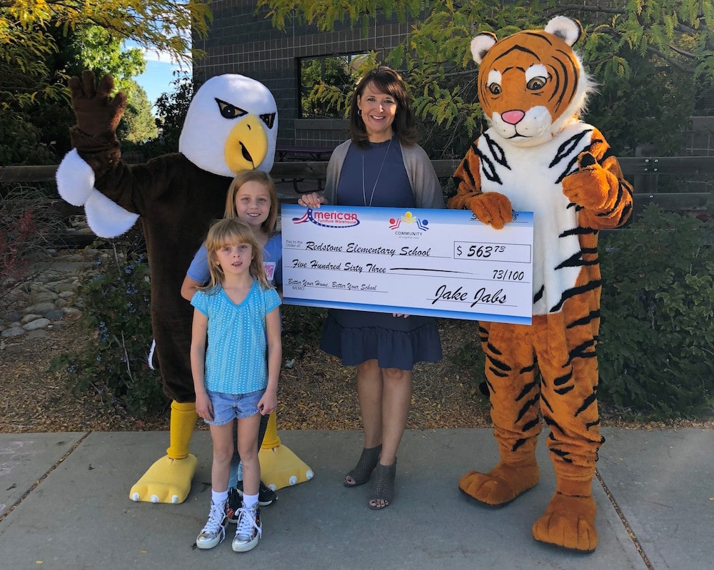 Presenting a check to Redstone Elementary