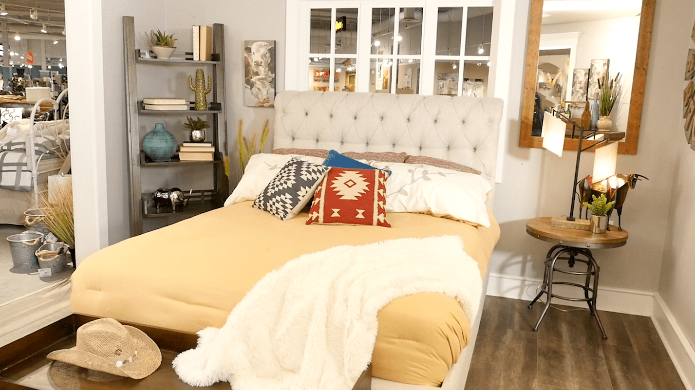 Rustic western bedroom with upholstered bed
