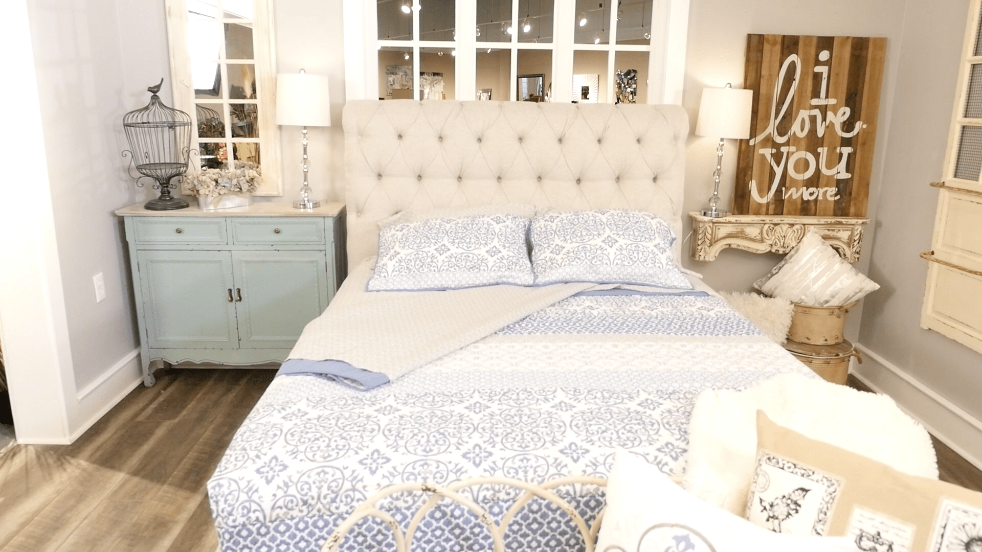 Shabby chic bedroom with upholstered bed