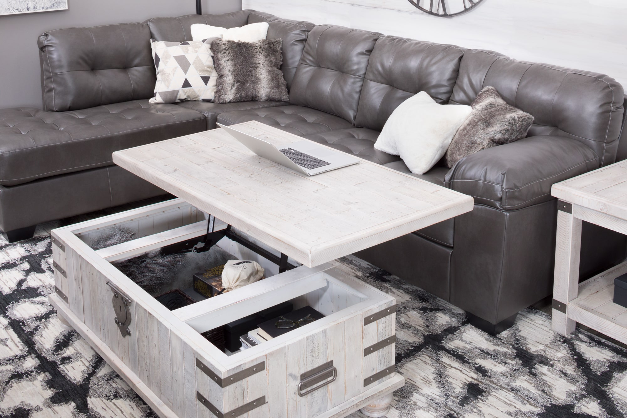 Lift top cocktail table showing storage underneath