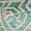 0108908_warley-aqua-wool-pouf.jpeg