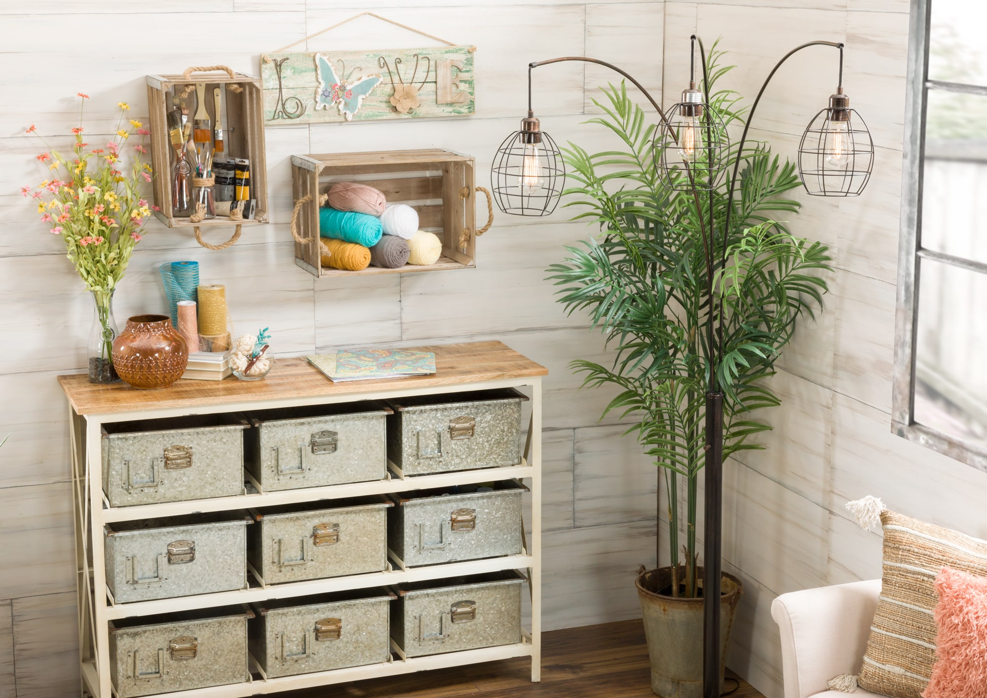 Vintage storage console with wooden crates hanging above it