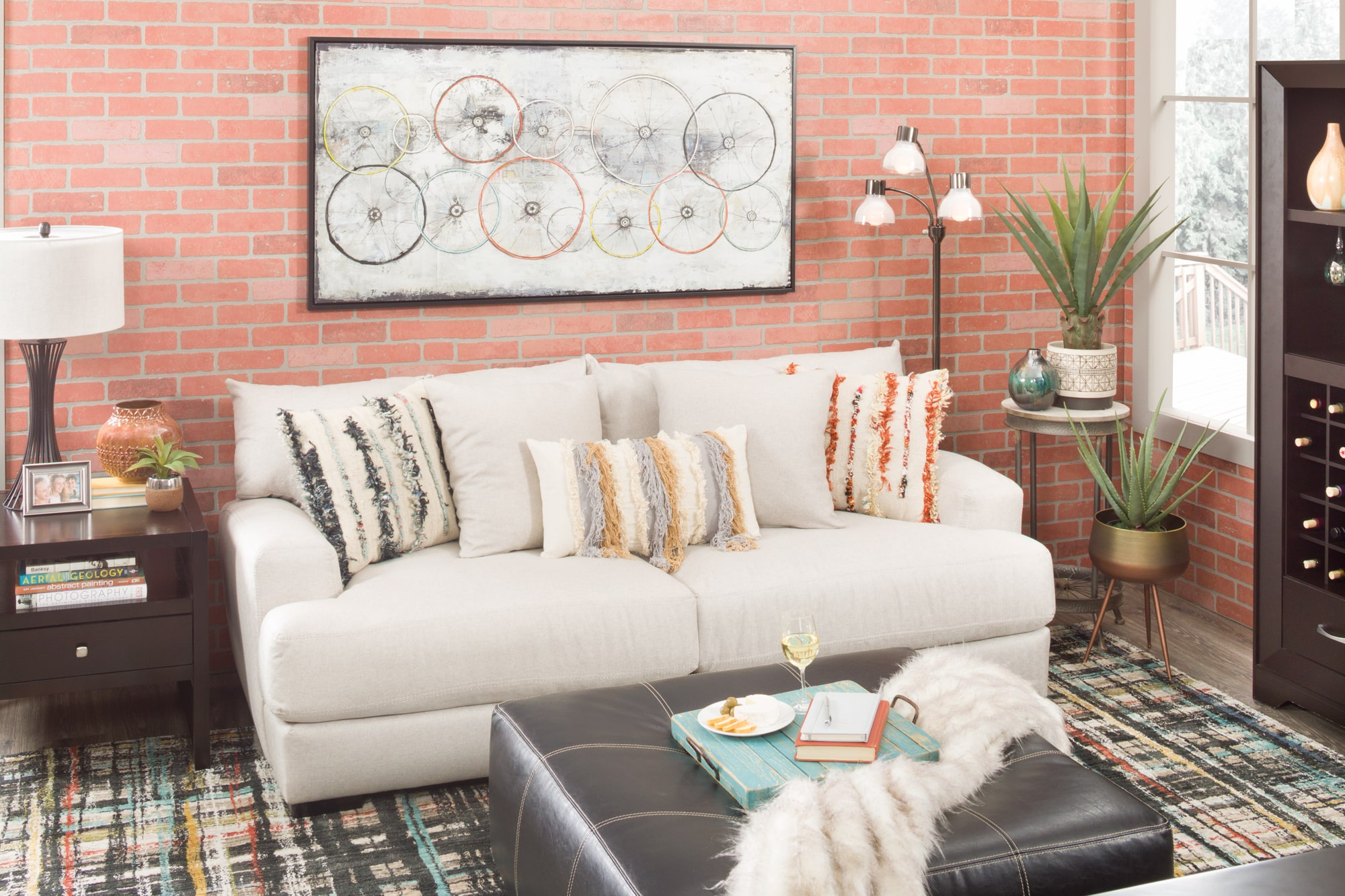 Cozy conversation area with sofa, ottoman, and rug