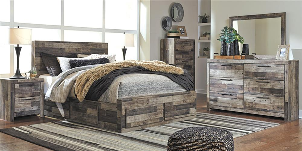 Bedroom with bed that has storage drawers in footboard