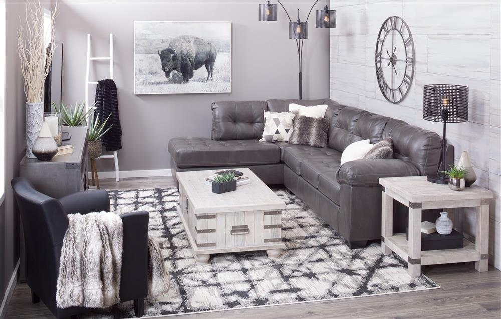 Living room with small grey sectional and lift-top cocktail table